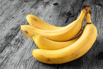 Ripe bananas on old wooden boards