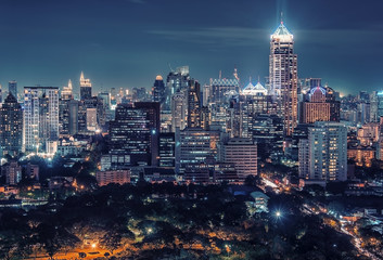 Lumphini park and the business district in Bangkok