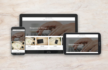 Concept image of multi device technology for responsive design presentation - digital tablet and smartphone in various orientation on a marble background.