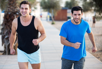 Two friends are jogging in time training