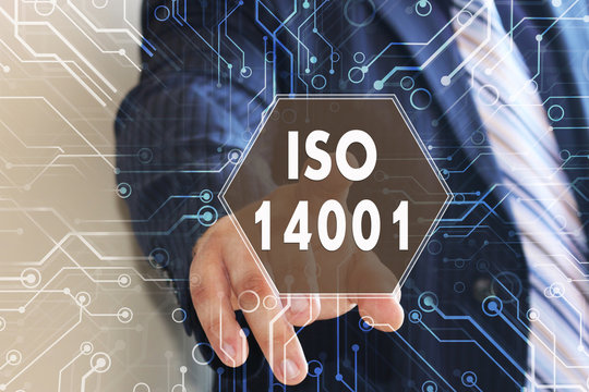 The businessman is choosing ISO 14001 on the touch screen with a futuristic background. Requirements for environmental management system and audit.