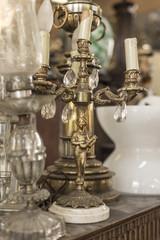 Brass candlestick with sculpture