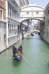 Colorful gondola under the Bridge Of Sighs, or Ponte dei Sospiri, San Marco, Venice, Italy