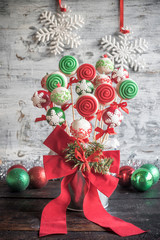 Christmas cake pops served on the wooden table,selective focus