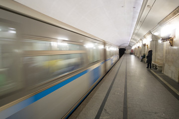 Subway cars speed by in the Moscow metro