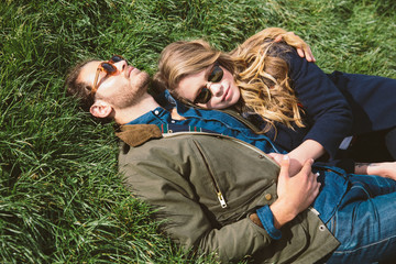 Couple relaxing in grass at city park
