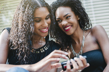 Happy young women using a mobile phone