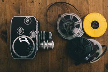 Vintage cinema camera and reels
