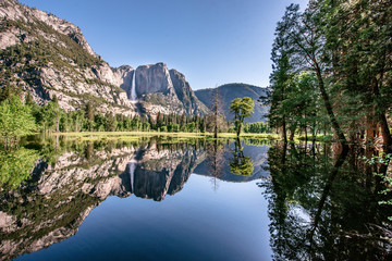 Yosemite National Park - Reflection in Merced River of Yosemite waterfall and beautiful mountain landscape, California, USA