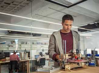Designer Working at a 3D Printer