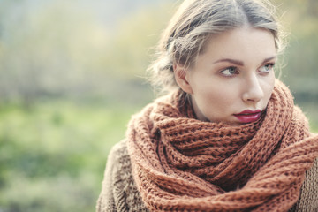 Portrait of a woman with scarf in nature