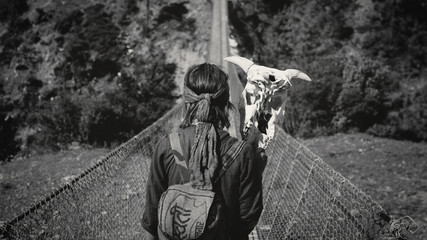 girl on the bridge with a skull