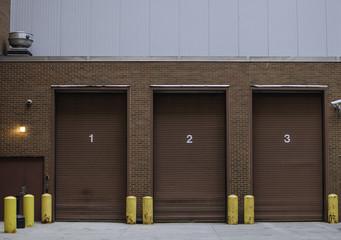 three numbered garage doors