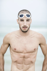 Portrait of young handsome swimmer
