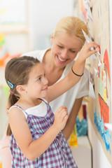 Preschooler and Her Teacher Making Paper Butterflies