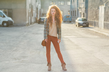 Young Red-Haired Woman on the Street