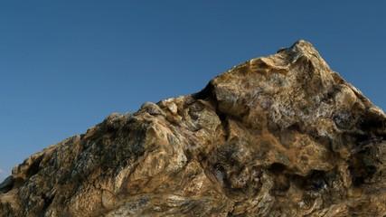 Rock /mountain in front of blue sky. 3D render 8.