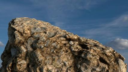 Rock /mountain in front of blue sky. 3D render 7.