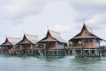 Resort over water bungalows on the sea on exotic tropical island