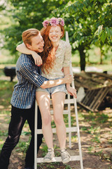 Smiling Ginger Couple in an Orchard