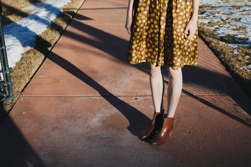 Girl in Vintage Dress and Boots - Legs