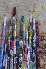 Used paint brushes with multicolored handles