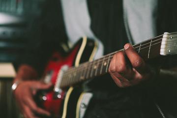 Musicians hands playing a guitar