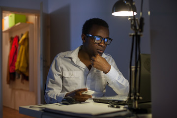 Businessman Working Late in His Home Office