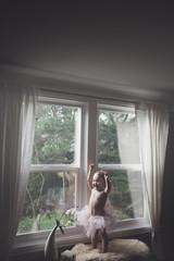 Cute toddler girl in tutu - cheering