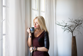 Woman Drinking Tea by the Window