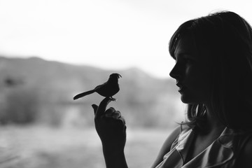 Beautiful Woman Holding a Fake Bird - Black and White