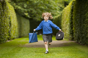 girl in school uniform running