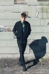 Super stylish teenage guy, outdoors