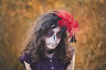 Girl's portrait wearing sugar skull makeup for Halloween