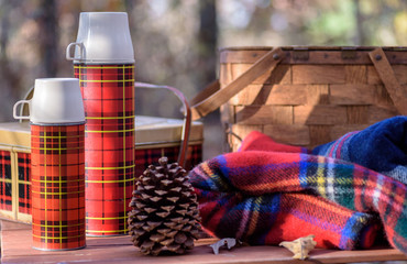 Vintage plaid thermos and tin basket - outdoor recreation concept