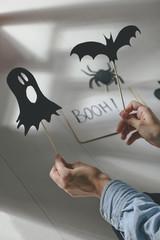 Halloween decoration. Girl making terrifying shadow puppet.