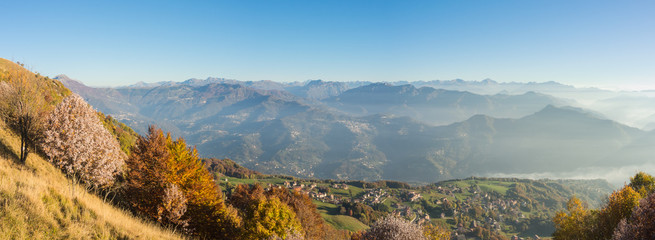 Great landscape on the Orobie Alps in fall time. Panorama from Linzone Mountain, Bergamo, Italy