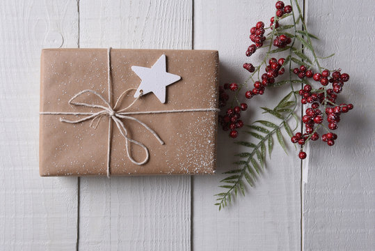 Plain wrapped Christmas present with a star gift tag