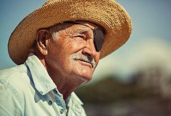 Portrait of an old man with an eye patch.
