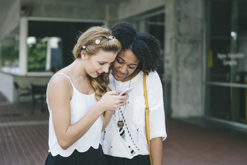 Two Young Women Looking at Smart Phone