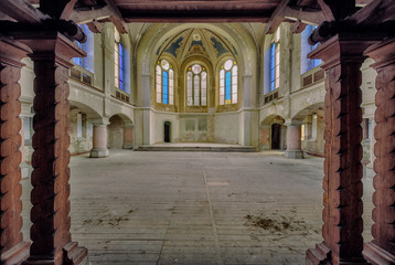 abandoned church with pillars and colorful windows