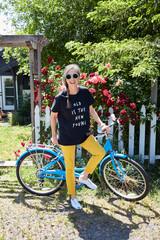 Portrait of stylish senior woman with bike