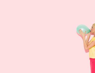 Colour Blocking: Woman Blowing a Balloon