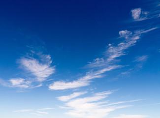 wispy clouds in a blue sky