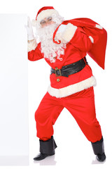 Santa Claus pushes blank white wall, advertisement banner with copy space. Isolated on white background. Full length portrait