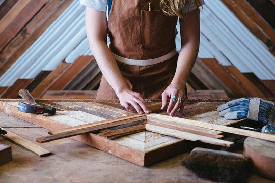 Wood making artist working in her studio