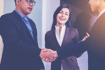 Business Partners Hand Shake in business meeting. co-operation concept