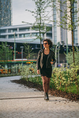 Young woman walking in the business district