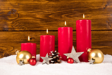red advent candles with balls and stars
