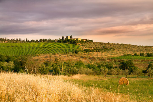 farm in the tuscany at sunset